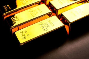 Gold rises while silver falls