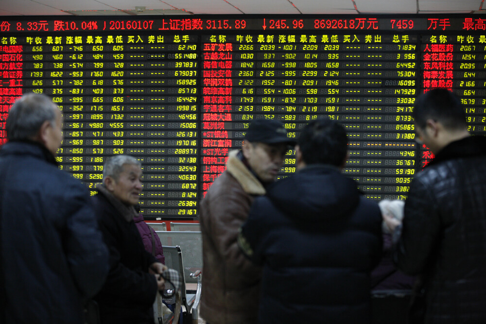 investors looking at stock market movements in Asia